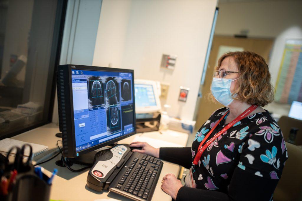 Jill Whiteley-Lamb reviewing MRI files at her computer
