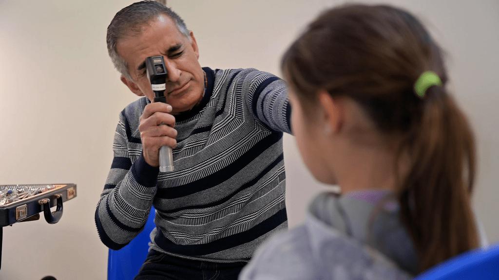 Dr. Kourosh Sabri examines the eyes of a child