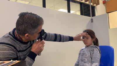 Dr. Kourosh Sabri performs an eye exam
