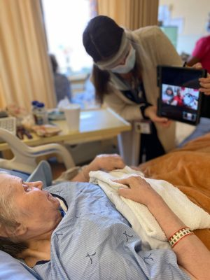Female palliative care patient interacting with Penny and Manu during virtual pet therapy