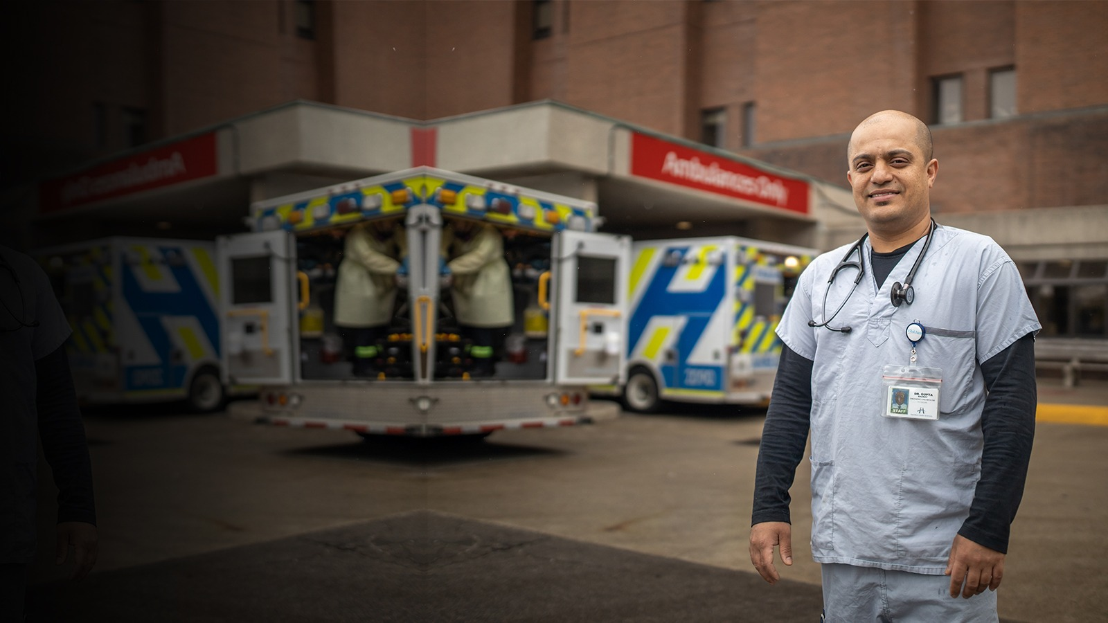 Image of doctor standing in front of the emergency department from the beginning of the COVID-19 pandemic