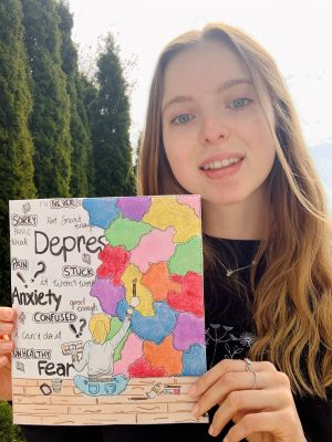 Anastasia holding her art. Hand drawn image of a young girl sitting in front of a wall with words and spots of colour.