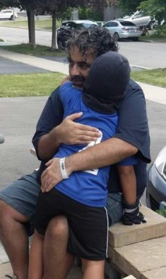 Anoop hugging his son