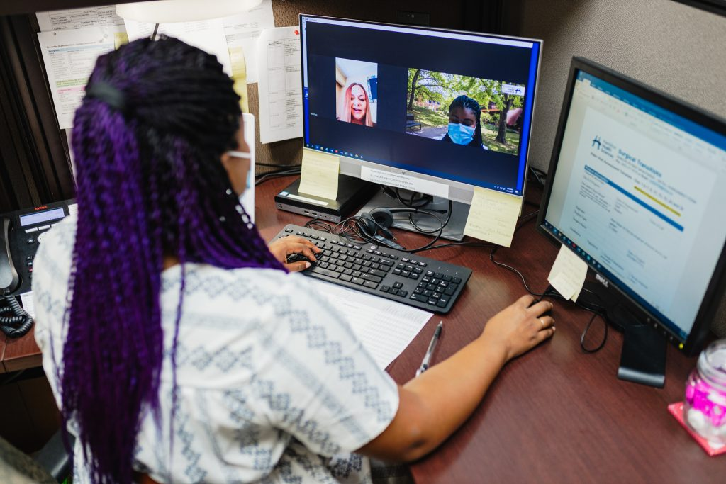 Nurse, Mikeera Dobson having a video call from the command centre for the surgical transitions program