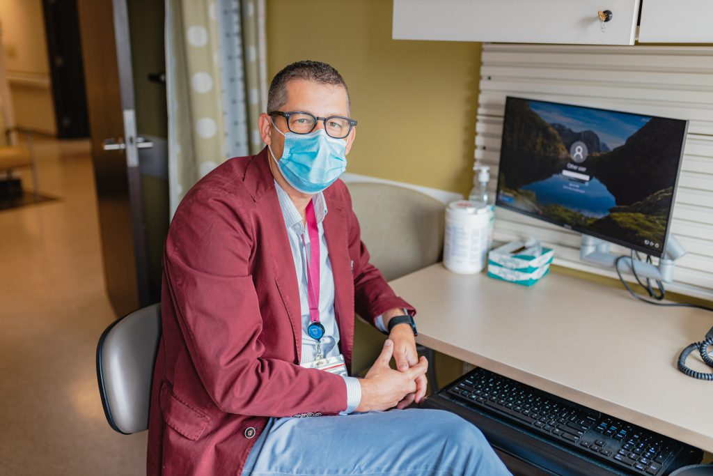 Dr. Cyr at his desk where he has virtual appointments with his patients