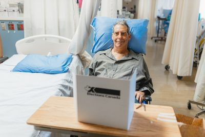 Patient David Veri votes in the federal election