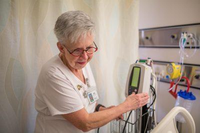 Registered nurse Barb Linkert caring for a patient